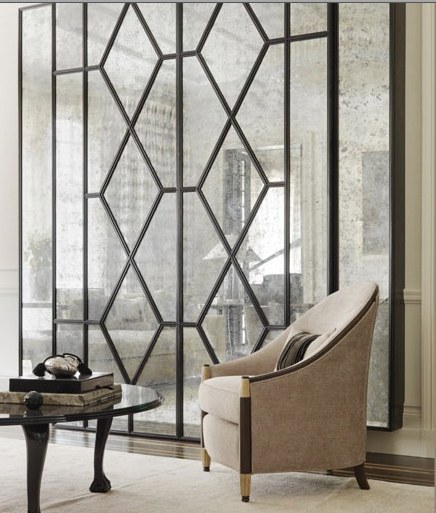 Beautiful modern millwork contrasts the antiqued mirror and sets the stage for the art deco chair. Hollywood glam!