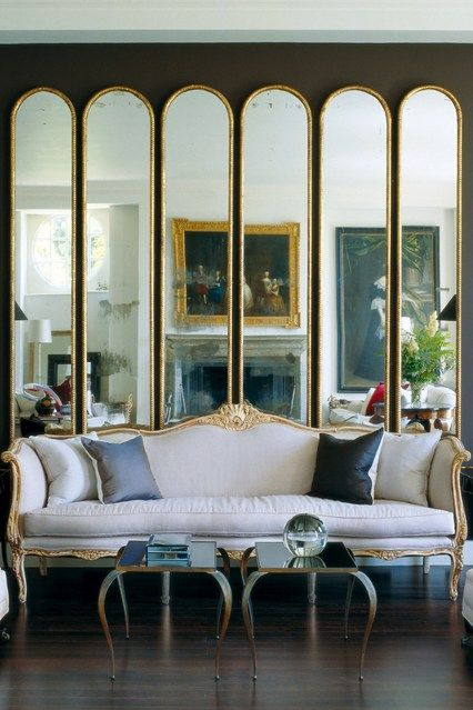 You don't have to adhere the mirrors to your walls to make a statement. Here's a mirrored screen. Now the artwork in the background can be seen twice!