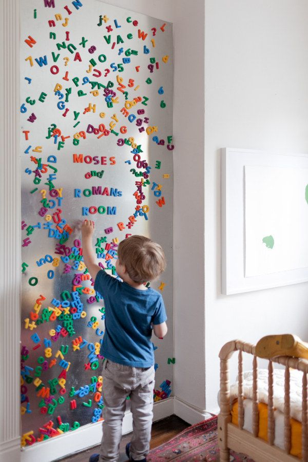 Piece of metal on the wall. Great for magnetized toys! Another idea that doubles as art and storage.
