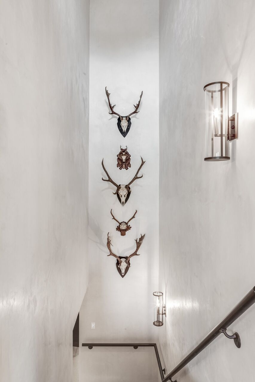 Stacking a row of vintage antler mounts was the perfect way to add visual interest to these white plaster walls. I can find a home for these anywhere. They bring the perfect amount of rustic luxe to any space.     These  Black Forest Antler Mounts  are straight from the antique market!