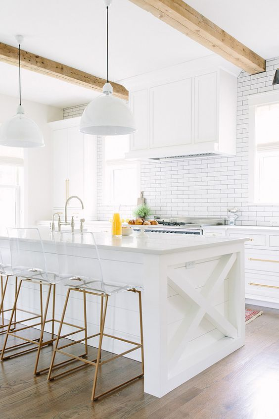 All white kitchen. :) Lucite and brass were made for each other.