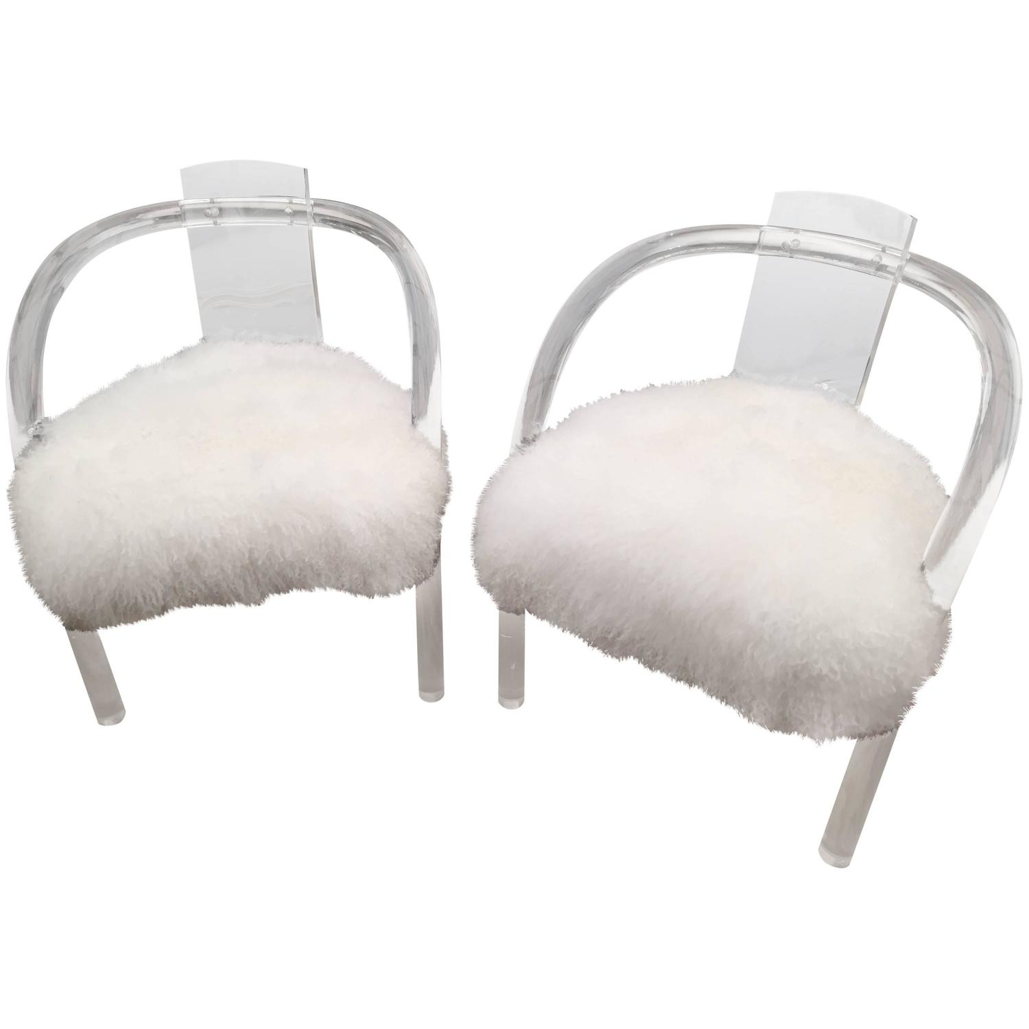 Antique Hollis Jones chairs covered in white Tibetan fur. Contrasting the modernist look with overwhelming texture.     This pair available at  Shop Tiffany .