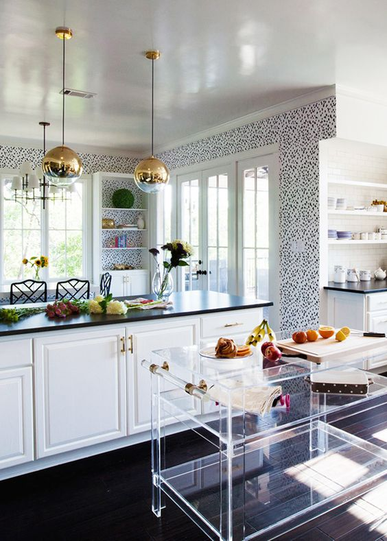 Such a whimsical kitchen. The lucite bar cart fits right in and adds texture without adding weight or color.
