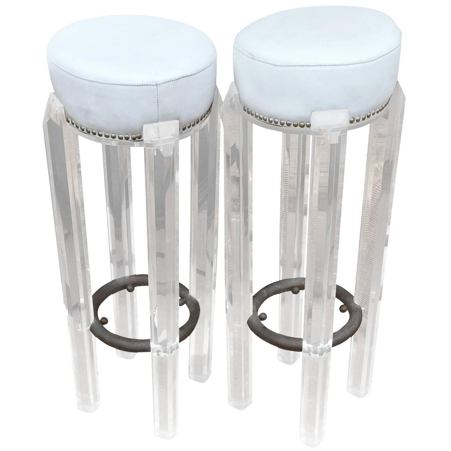Lucite never goes out of style. These 20th Century barstools are just as funky as ever.     Available at  Shop Tiffany .