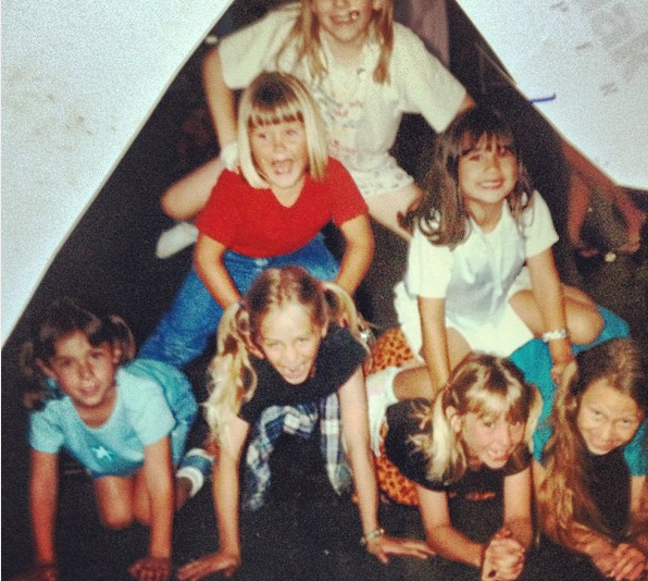 Irene and I as little children being ridiculously adorable. Irene is in the blue top and I'm in the blonde pigtails and orange skirt.