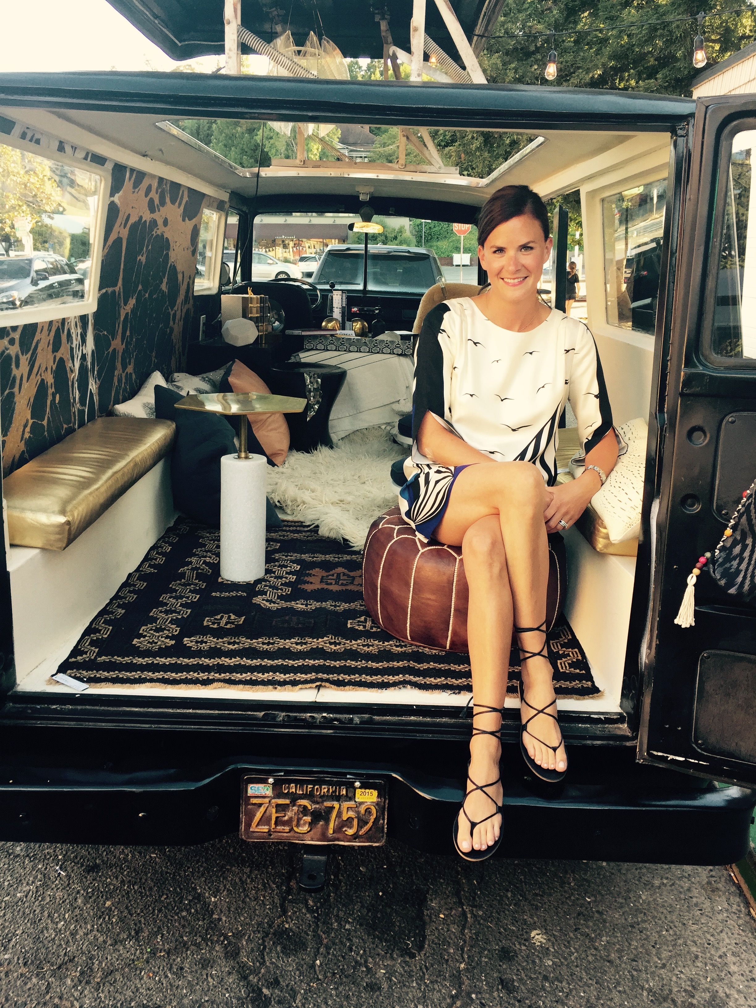 i wore atibi dress (past season)andmadewell  sandals . perched in the  clubhouse caravan  in front of the shop.
