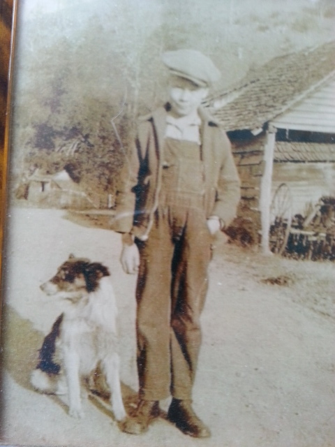 """""""Coffee Jack"""" Utsman with his dog """"Grip"""" as a child in Rogersville, Tennessee."""