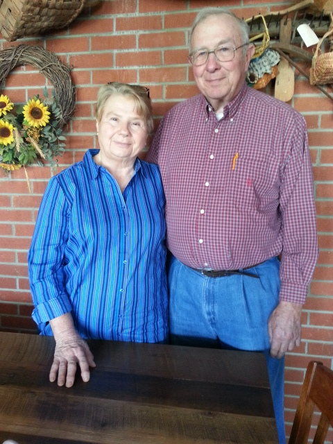 Susan and John Keller, owners & farmers of Kelmont Farms, Maryville, Tennessee.. Pictured with the table John had made for Susan out of salvaged lumber out of a barn that was torn down from Susan's Hitch Family Farm in Blount County, Tennessee.