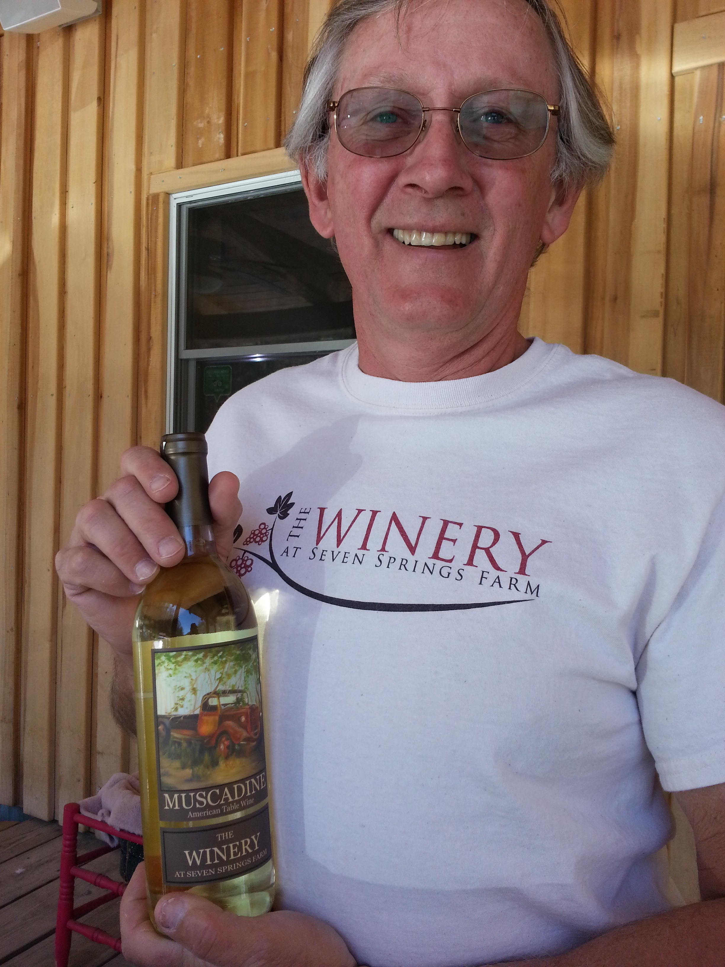 Rick Riddle holding a bottle of the award winning Muscadine wine from The Winery at Seven Springs Farm, Maynardville, TN.   https://www.facebook.com/theWineryatsevenspringsfarm/