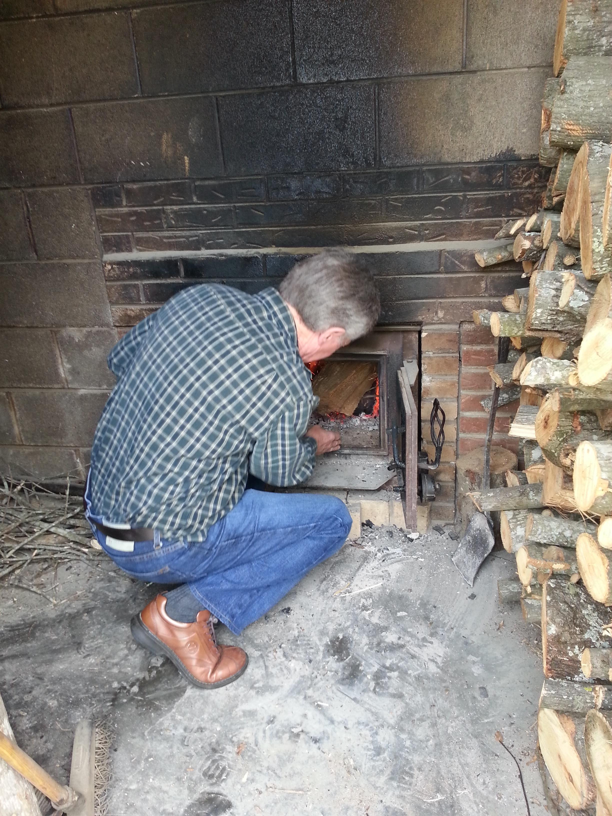 Allan Benton feeding the fire.