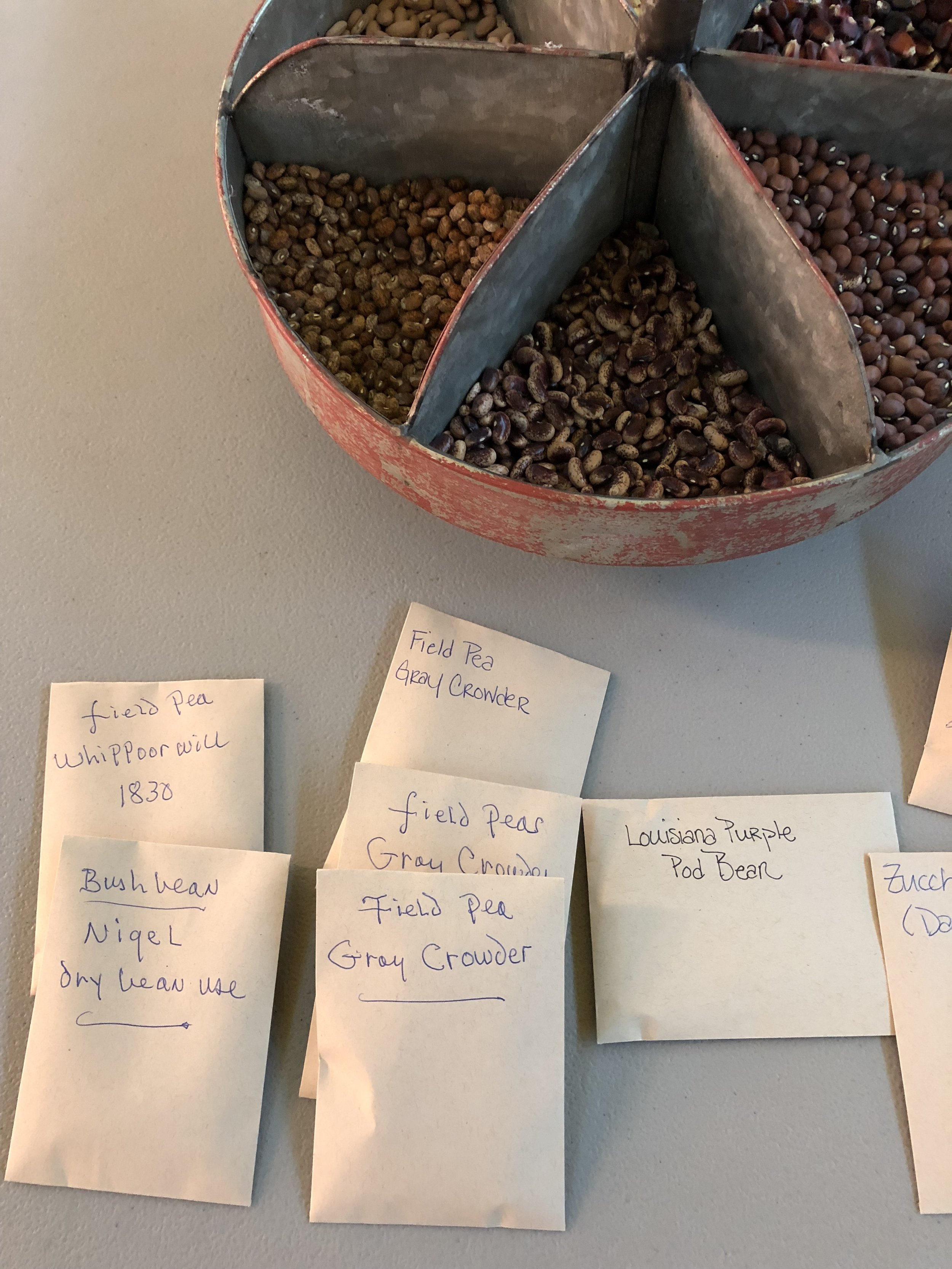 Some seed packs with John's writing.