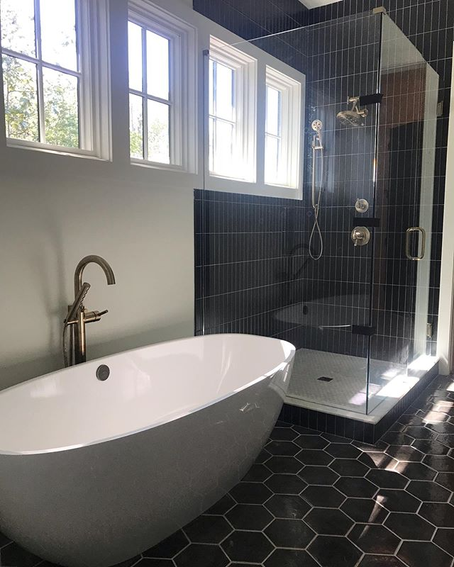 this home isn't quite finished (almost!!), but it's too cool not to share. This family has the  best taste.  They plan for lots of color and wallpaper when they move in. Swipe to see a mini tour of the progress ⬅️ @1023construction builder #stevedray architect @traditionsintile @fergusonshowrooms @serenbe @jerseyshorejaime @bellcabinetryanddesign