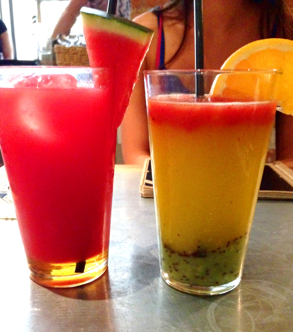 Left: Summer Recovery withcoconut water, watermelon, mint & agave syrup Right: Antiox withstrawberry, kiwi, orange and lemon