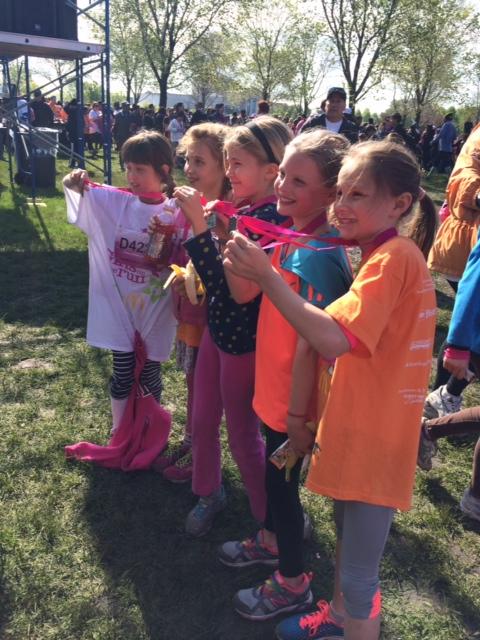 My girls sport their 5k finisher medals.