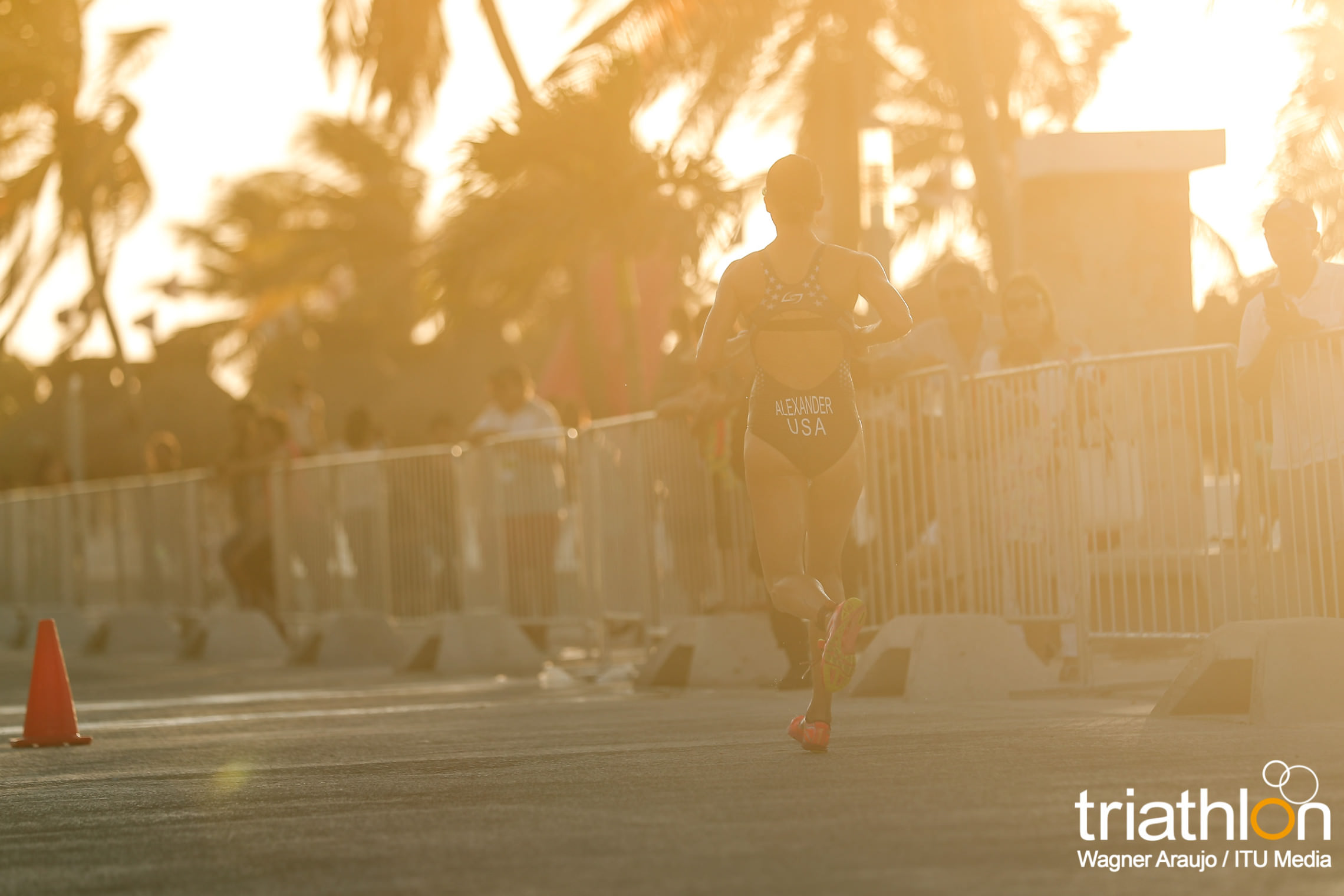 Racing into the sunset! Photo Credit: Wagner Araujo/International Triathlon Union