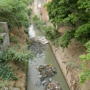 Channels and rivers are used as open sewers. (Photo credit: Joan Rose)