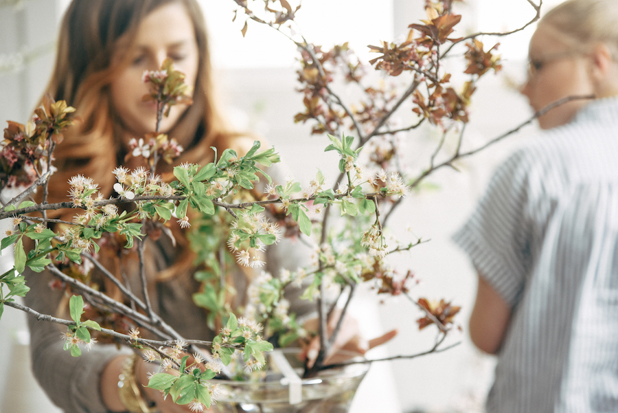 Blooming or even non-blooming branches provide depth, height and authenticity to a flower arrangement as seen her at Nicole Land's Soil & Stem Spring Floral Design Workshop now featured on Cottage Hill