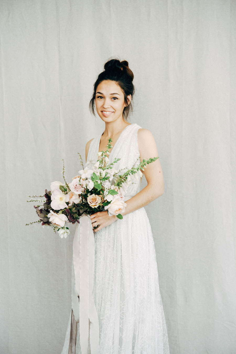 Simple joy. We love seeing a happy bride. So many editorials are so serious in the name of 'fine art.' Fine art can also capture joy; actually, we prefer it! See more captured by Tess Comrie at Soil & Stem's Spring Floral Design Workshop now on Cottage Hill