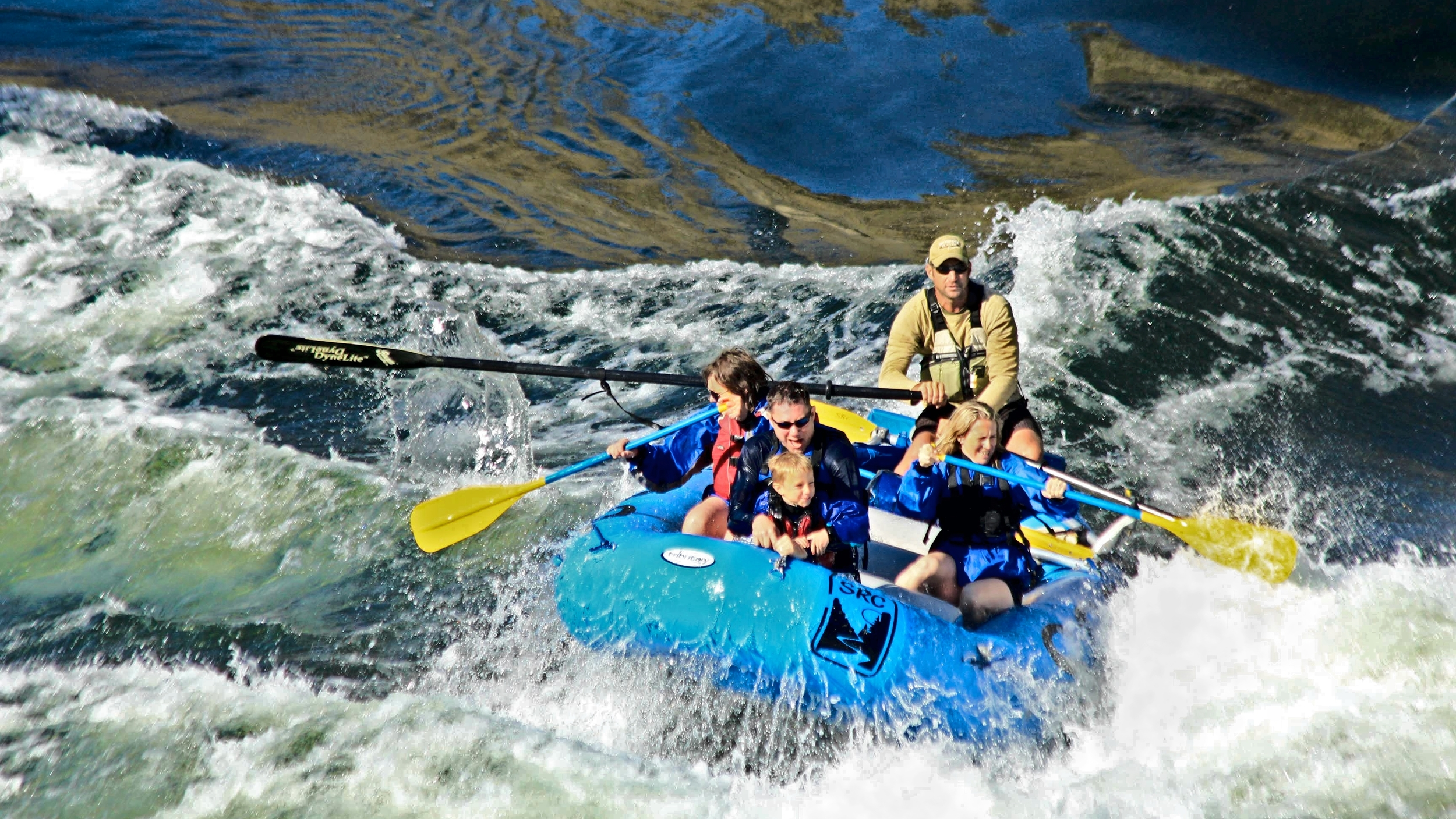 Family getting wet rafting on the Salmon River in Idaho near Riggins and McCall