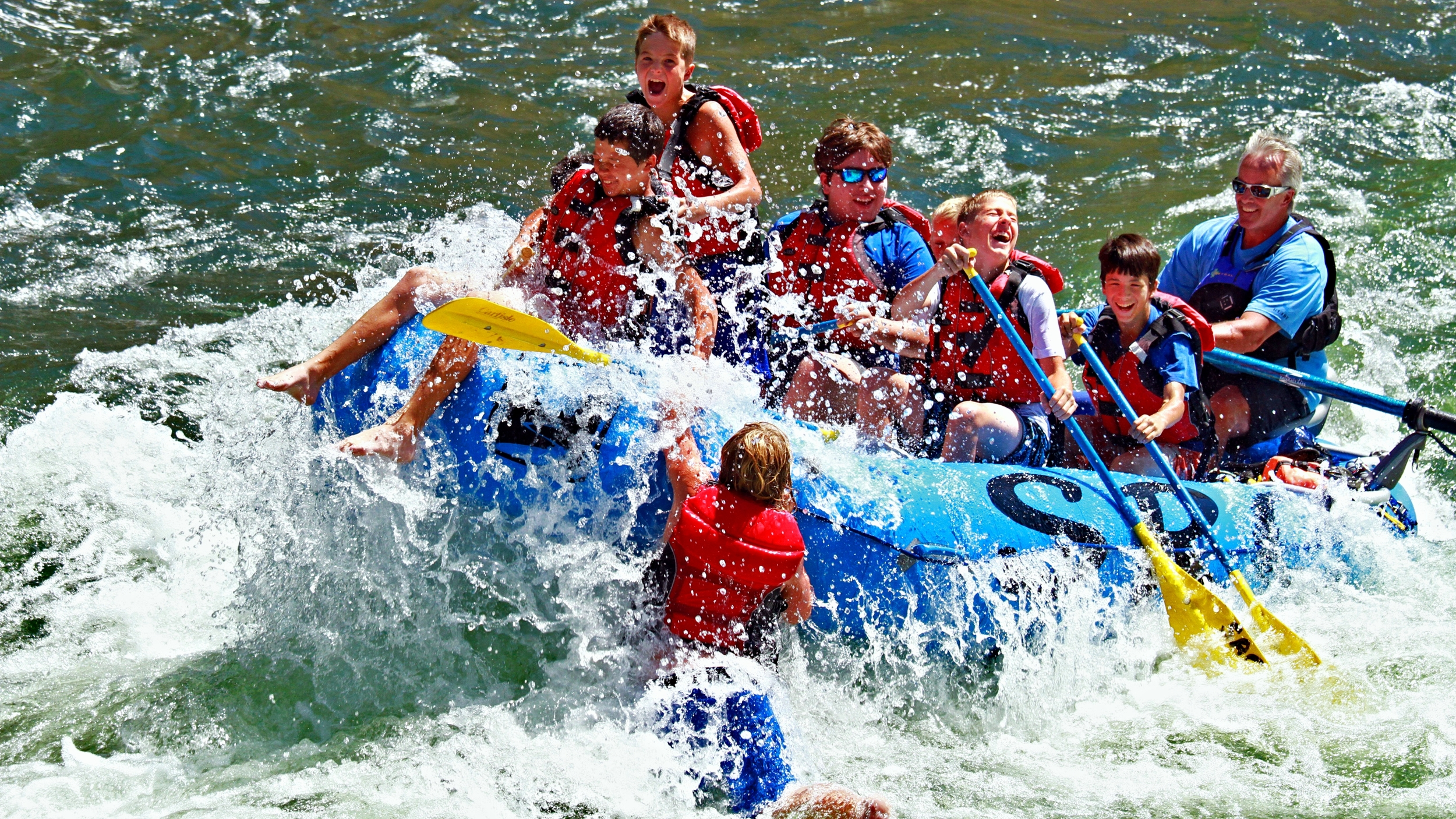 Kid getting a big ride and short swim when rafting the Salmon river near Riggins