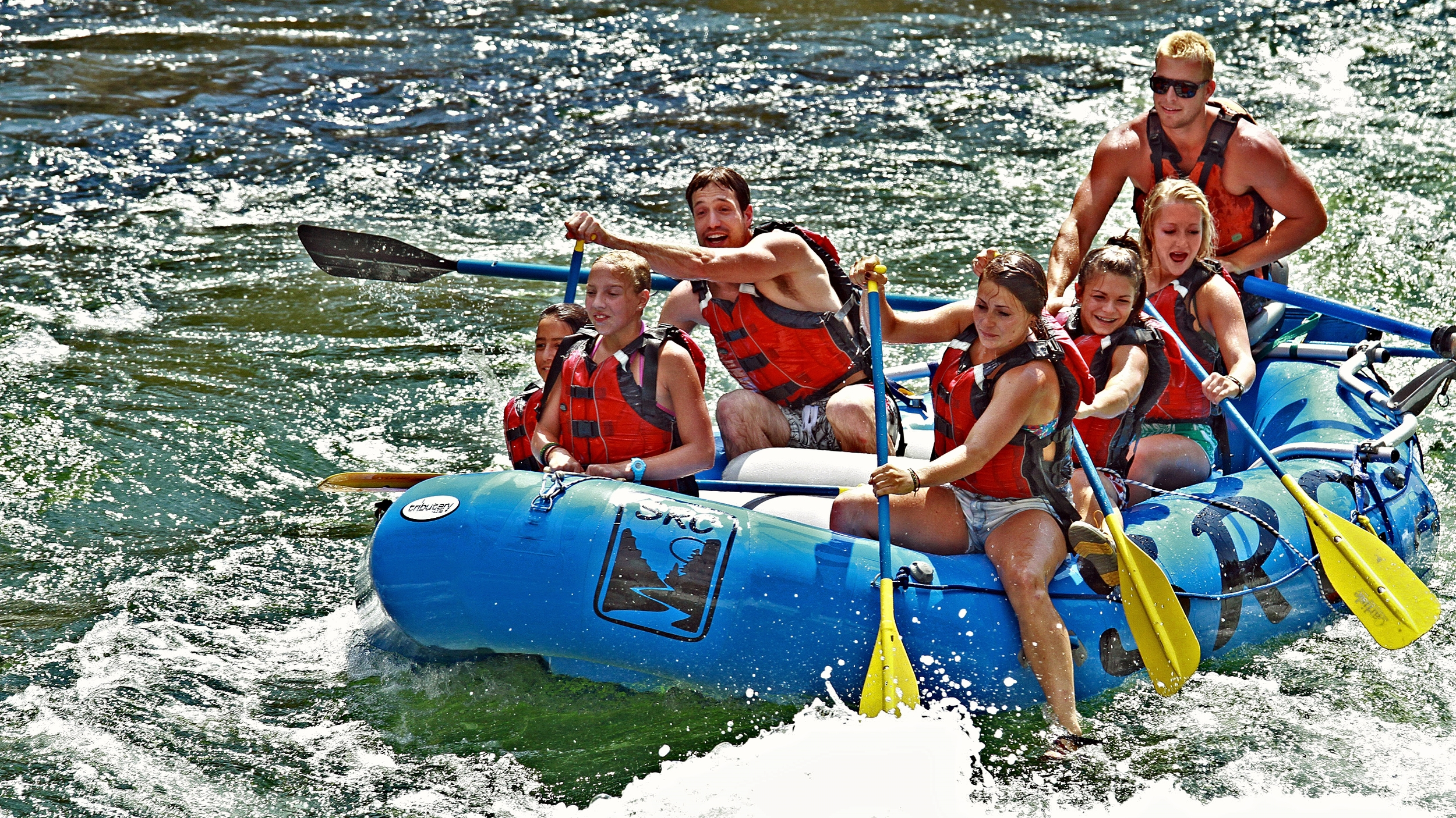 Group relaxing while whitewater rafting near Riggins Idaho.
