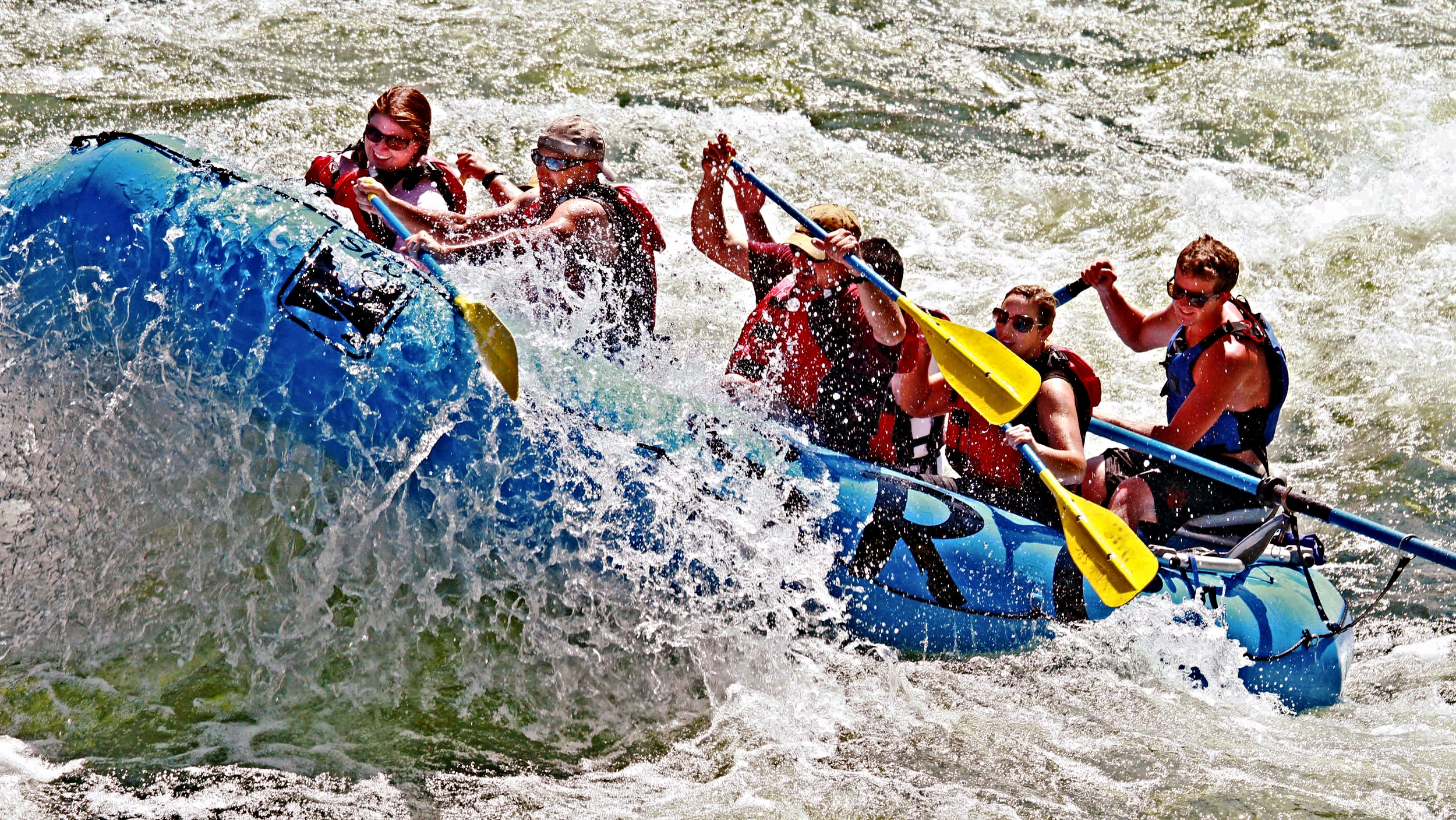 Group getting a big ride in the waves of Timezone rapid on the Salmon River near McCall Idaho.