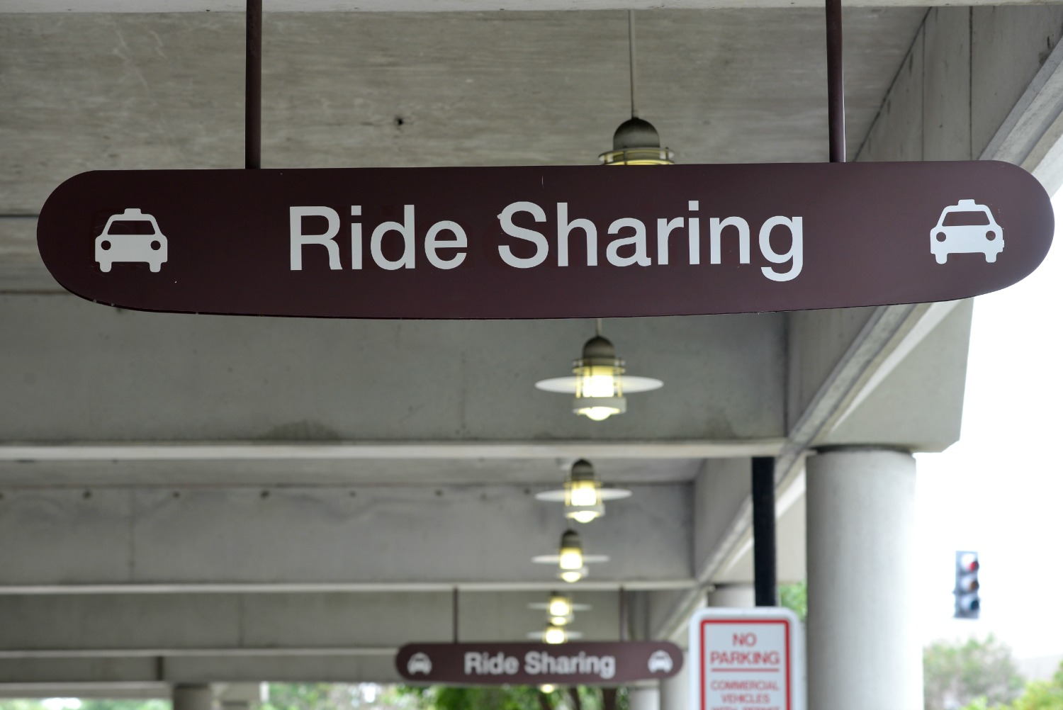 Signs at Nashville International Airport designating the new pickup zone for ridesharing passengers.