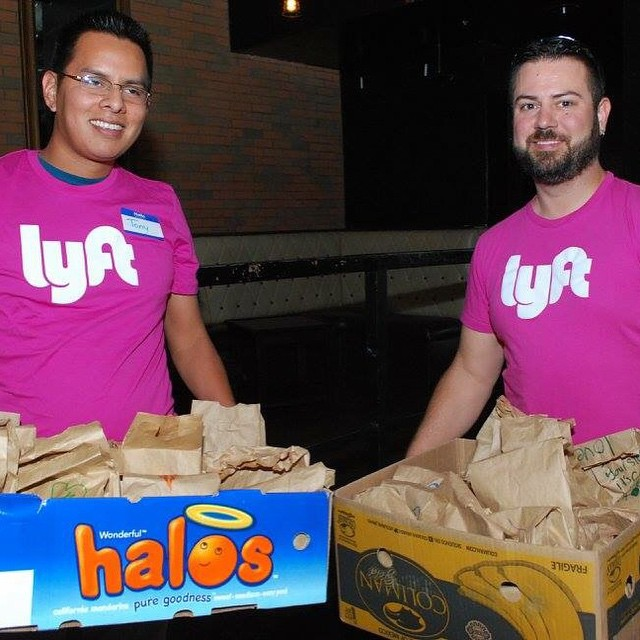 Drivers deliver bagged lunches in Phoenix.