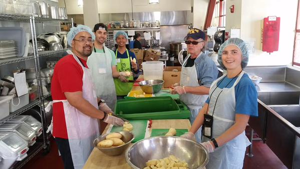 Order up! Drivers take the afternoon to assemble meals for those in need.