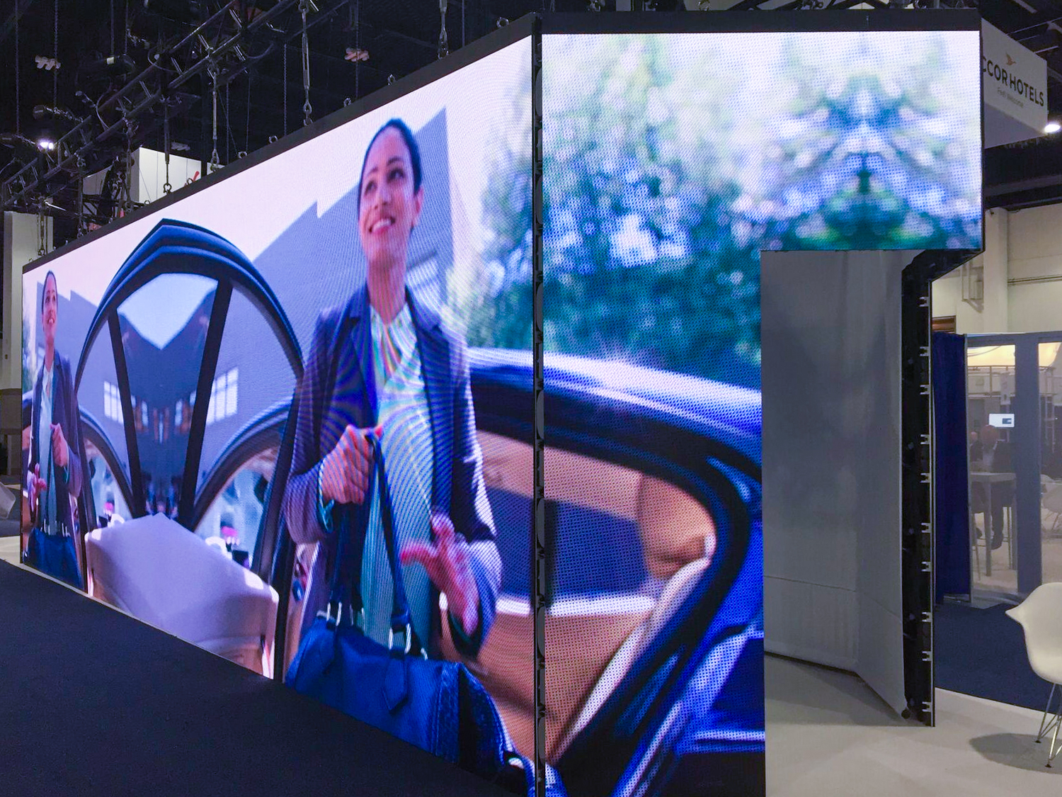 Our booth gave visitors an immersive ridesharing experience with videos on 40' LED screens.