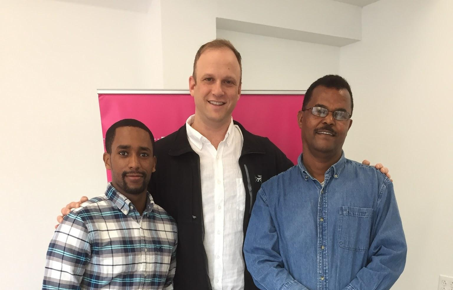 Abraham's son, Harouc, (left), Philadelphia General Manager, Andrew (center), and Abraham (right), contest winner, at the Lyft Philly office.