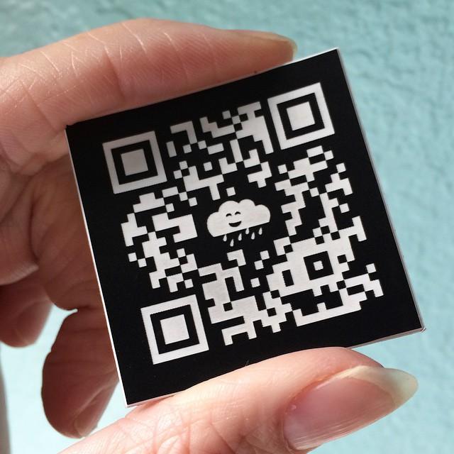 Laser engraved QR code.