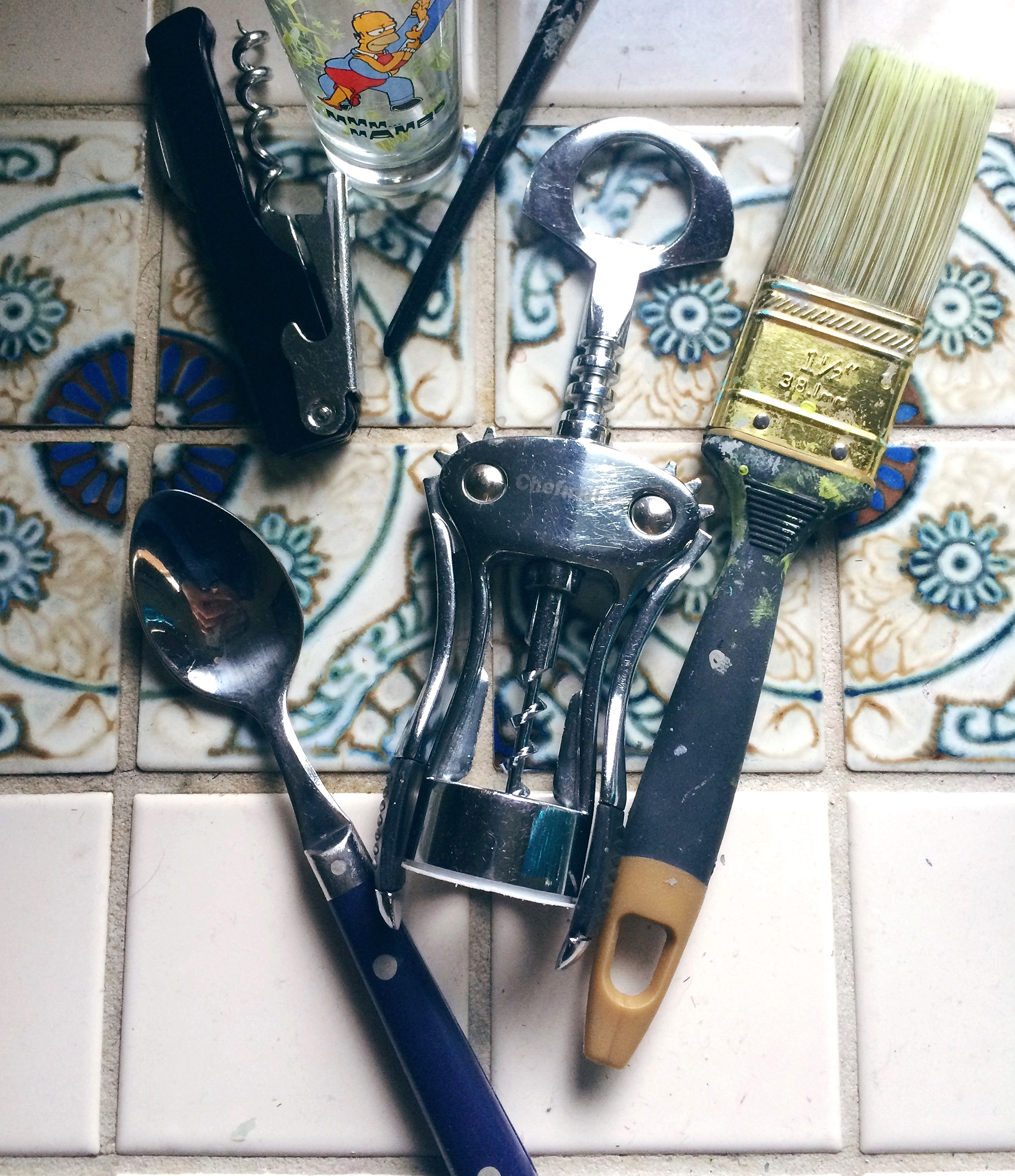 Wine bottle openers, paint brushes, spoons and a shot glass = evidence from working late at night.