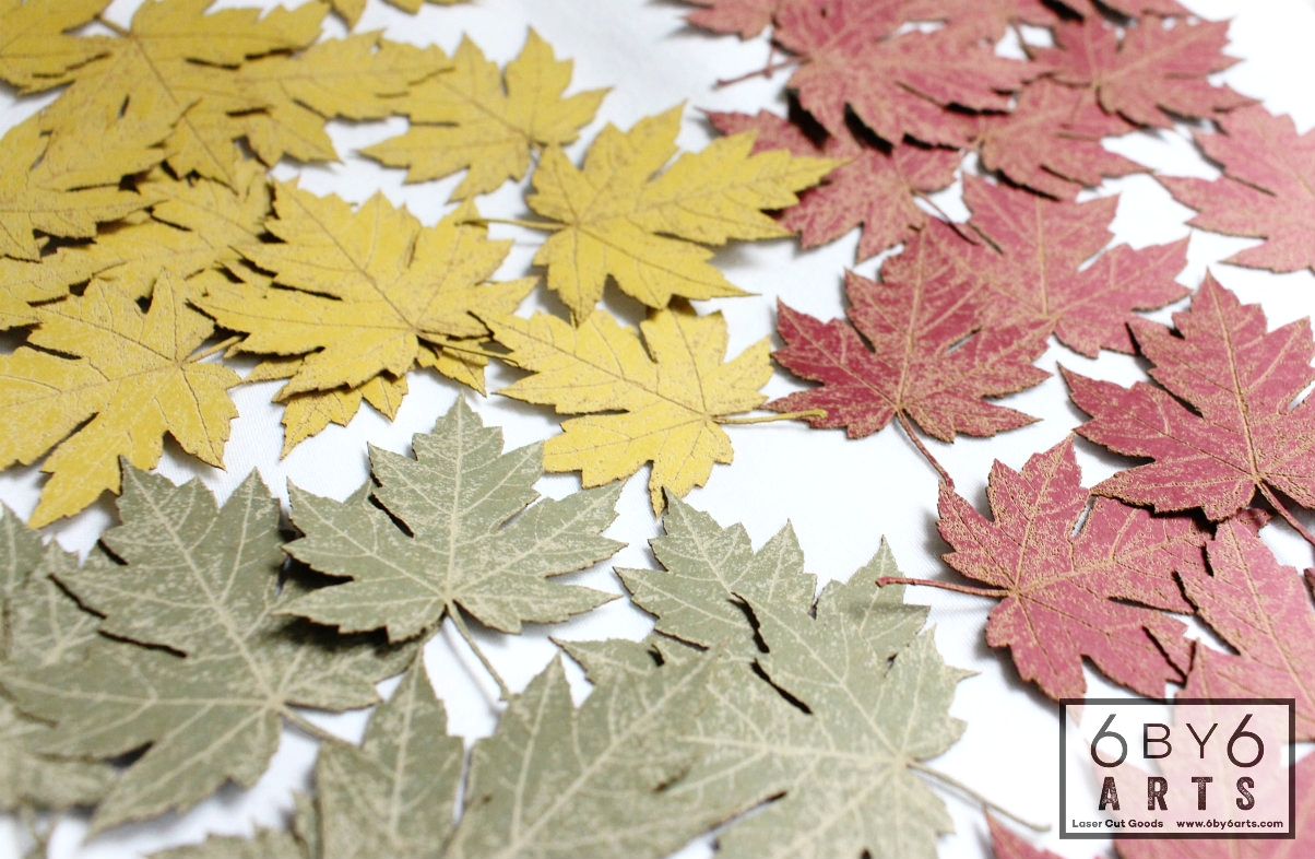 Laser cut and engraved paper leaves by 6 by 6 Arts