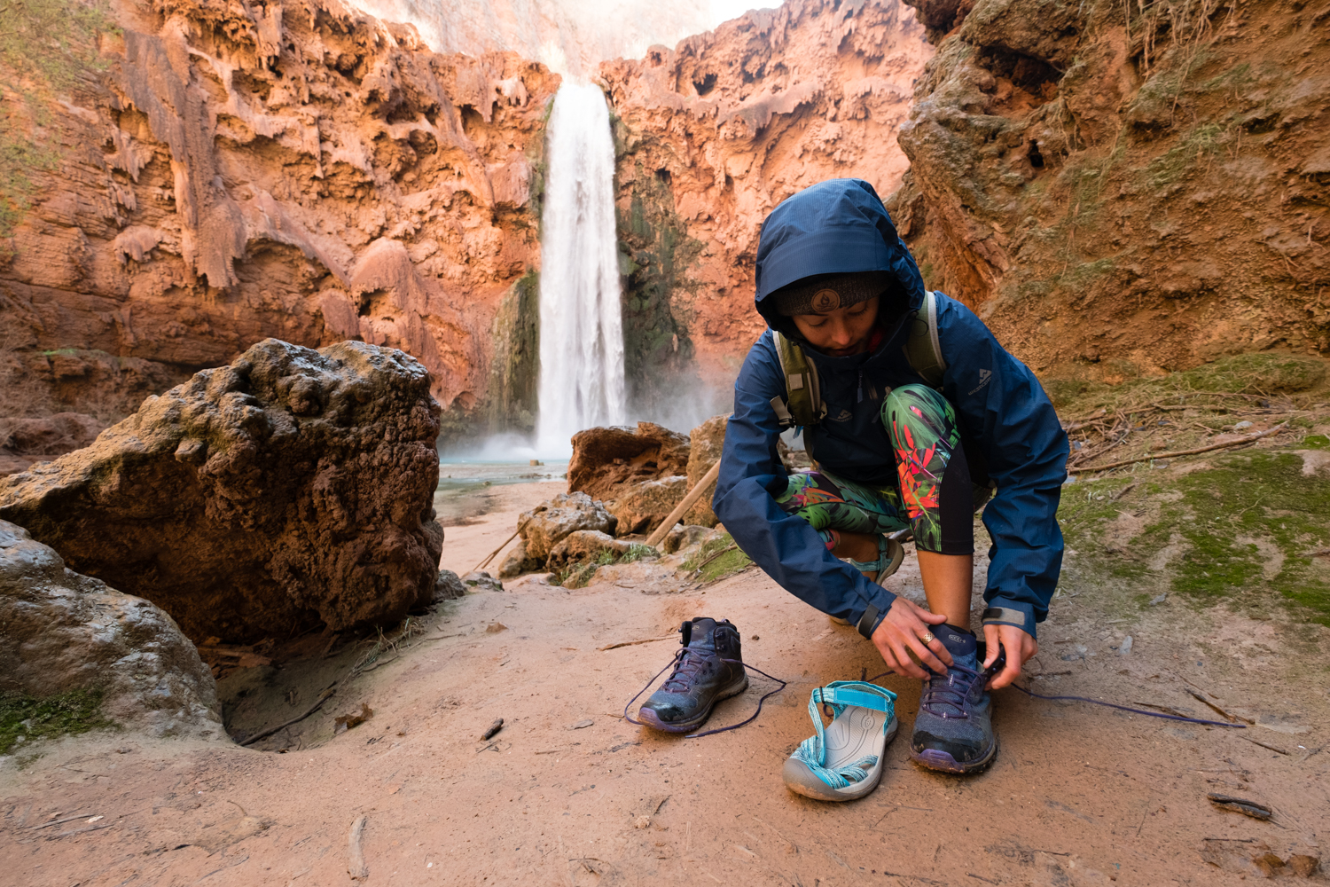 Switching shoes at the base of Mooney Falls. Photo By Travis Burke