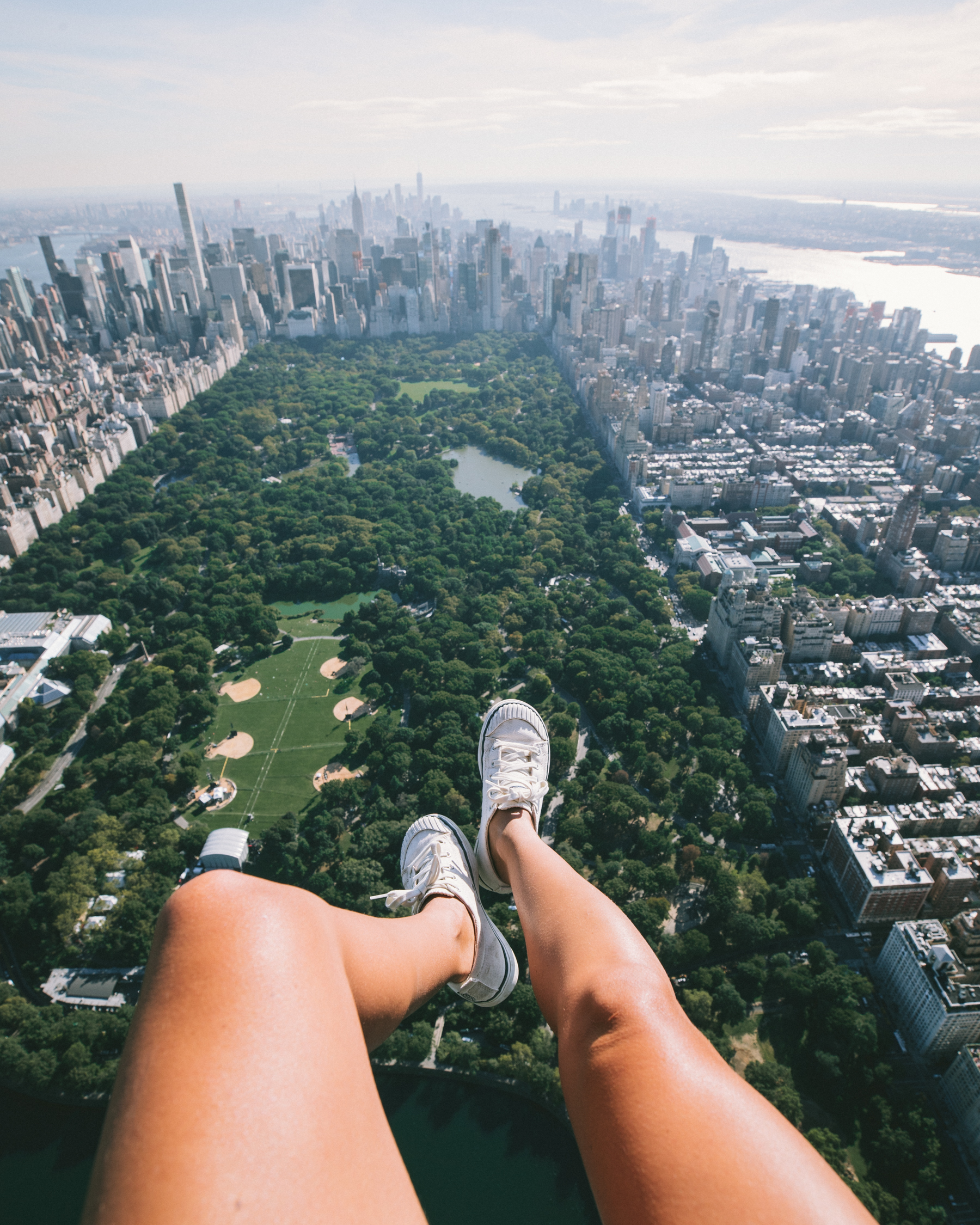 Foot selfie out of the helicopter over Central Park. That clearing to the left of my feet is the area for the concert. I'm harnessed in, don't worry :)