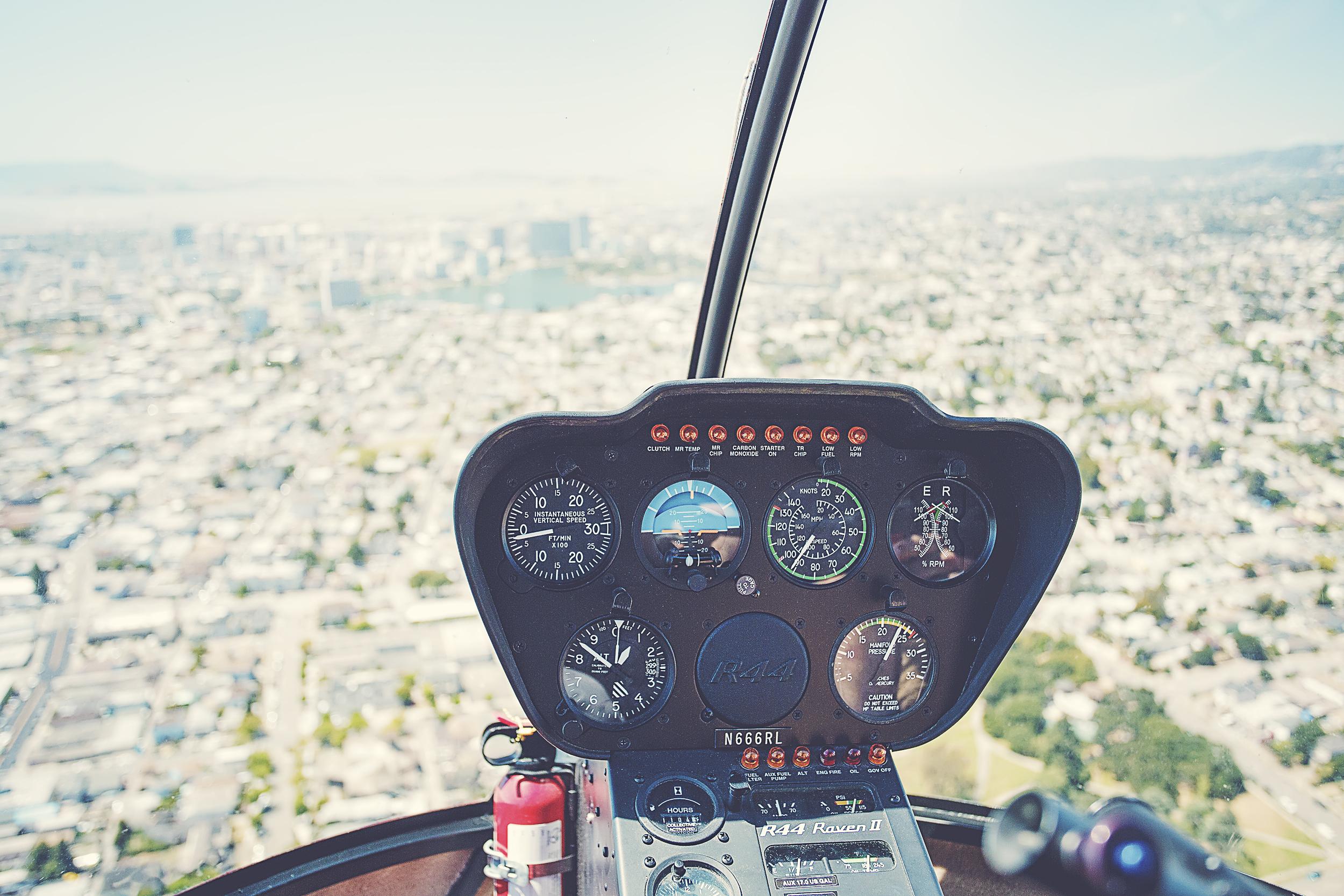 Cockpit view flying over Oakland toward Lake Merritt