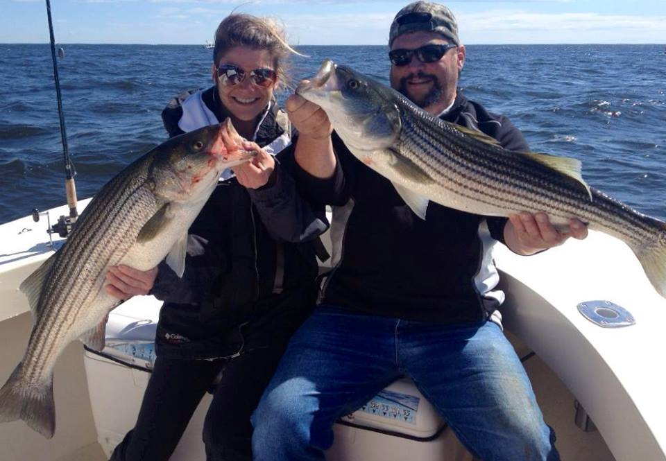 Jessie and her dad Steve with a nice pair of keepers on a double hook up on Father's day