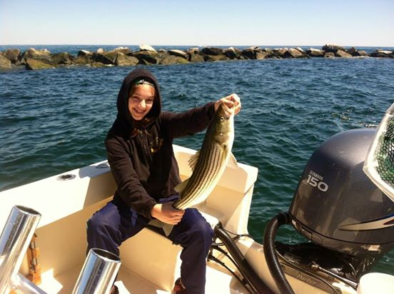 Lindsey with a nice Merrimack Striper on Manolin Charters