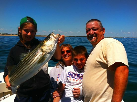 The Joubert family with a sweet 35 inch Striper caught trolling live mackerel