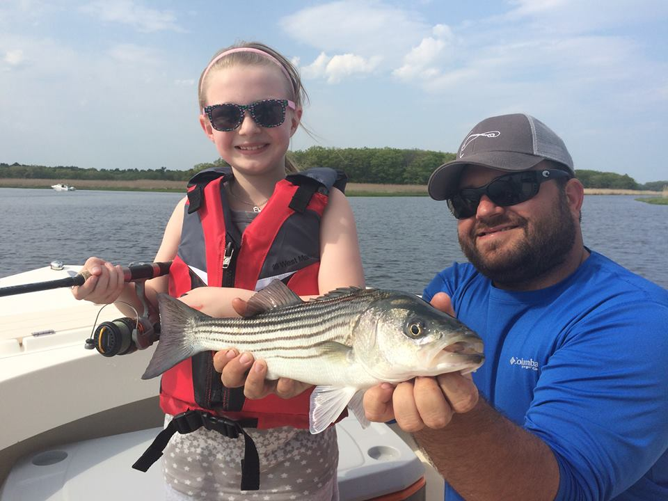 Ellie with one of her 91 striped bass caught on Manolin Charters