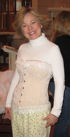 Cathy Marie Hake had brought some modern-day corsets and strapped me into one. You can tell it's modern-day because it covers the breasts. The period ones only lifted, but did not cover. Looks nice with my flannel pjs, huh? :P