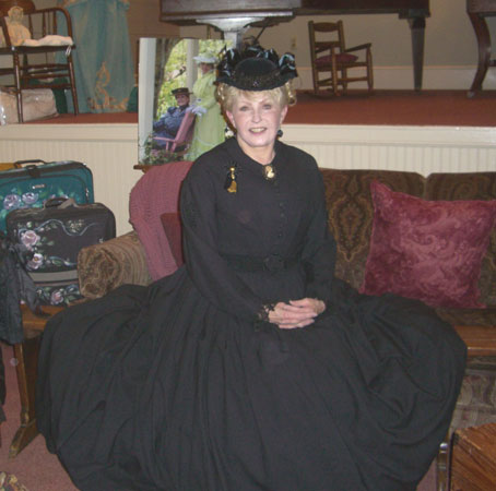 Cathy Marie Hake insists that corsets that fit correctly are great for back support. I can tell you this, they certainly do make for pretty posture--as you can see with our Victorian Lady!