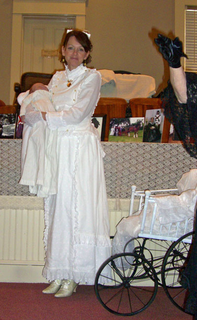 The next day the Victorian Lady came back and did a program on Victorian maternity costumes and motherhood. This is one of her models in a Victorian nursing gown. Do you see the buttons on either side of the bodice?
