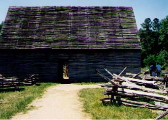 This is a tobacco barn. You can't really tell from this picture, but there is a bit of space between each log. This allows air to flow through the building while the tobacco dries.