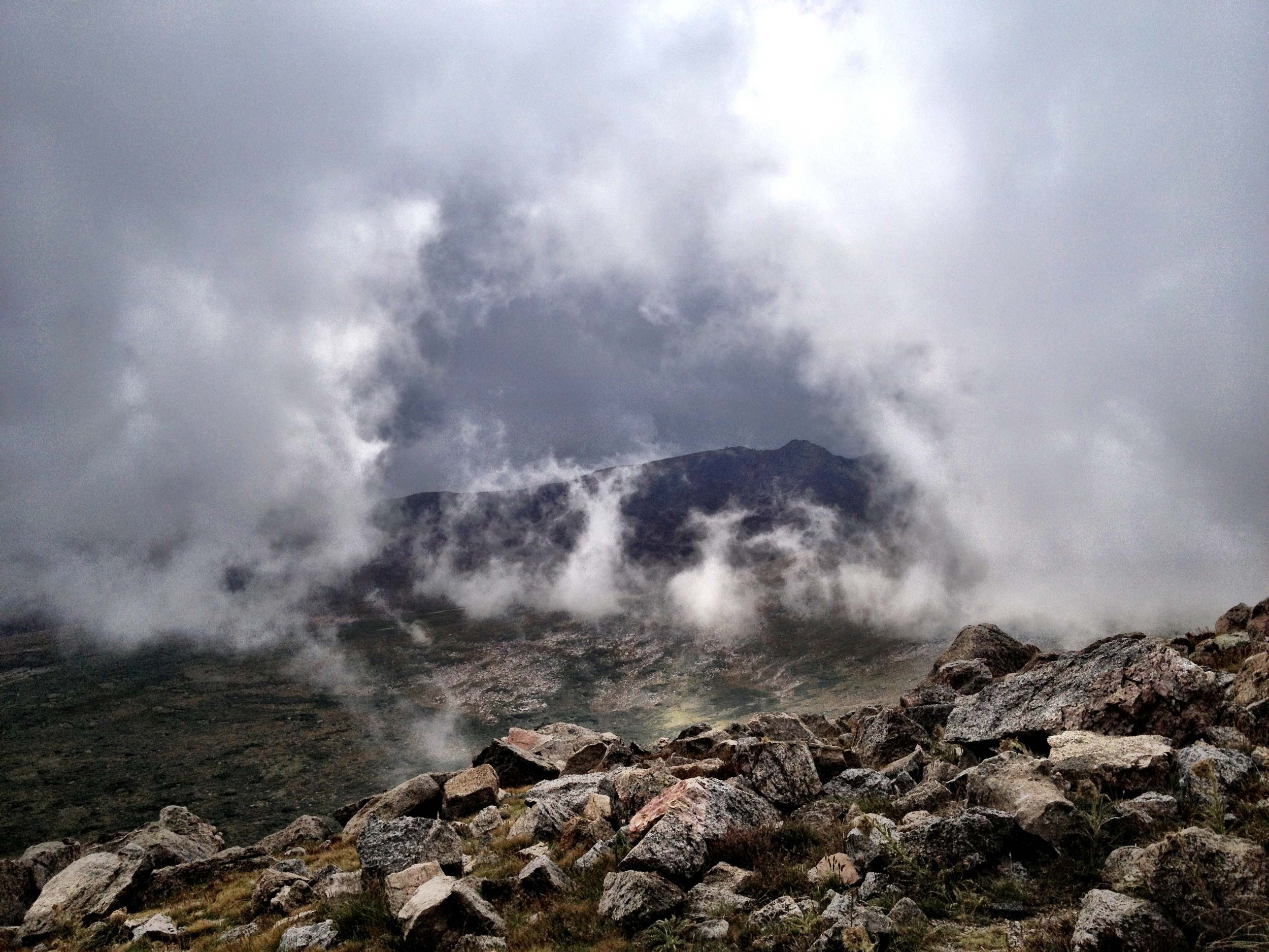 Clouds consume the boulders at Lincoln Lake.