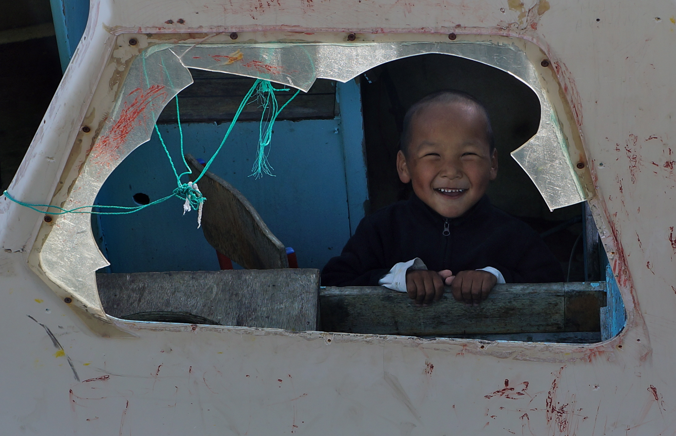 A child in a small village in Southeast Greenland