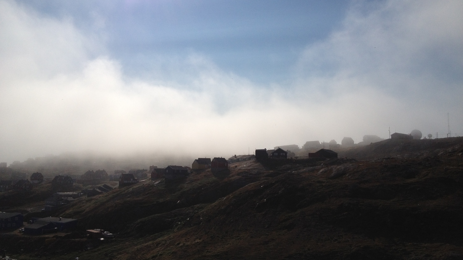 Houses in the morning fog in Tasiilaq, Greenland