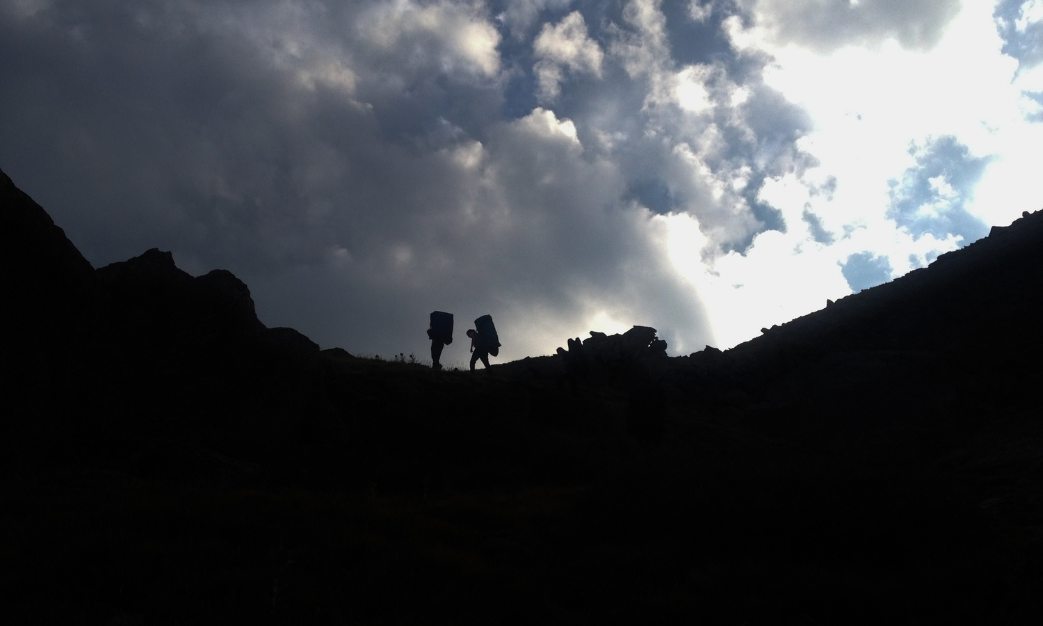 Hiking out of Lincoln Lake after a long day of bouldering.