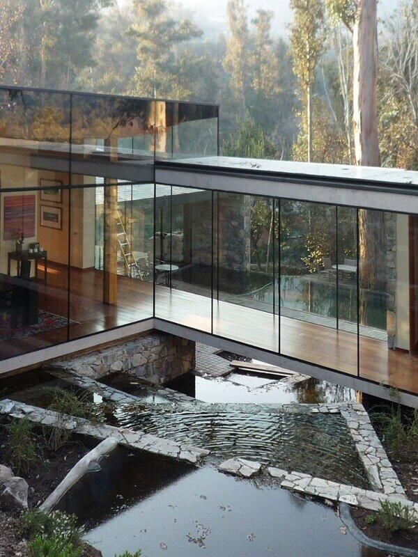 Glass walled mansion in forest ITCHBAN.com